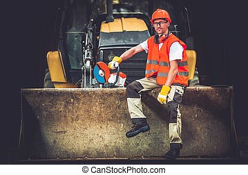 Happy Construction Worker. - Bulldozer Works Concept. Young...