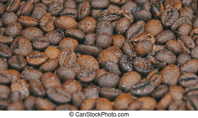 Coffee Beans Rotate - Coffee beans rotating on a wooden...