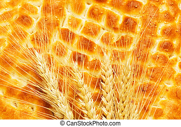 Nutrition concept with fresh bread and wheat ears