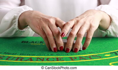 dealer handling playing cards at a poker table