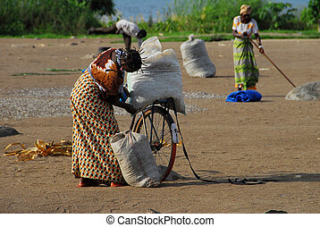 African woman with her bicycle