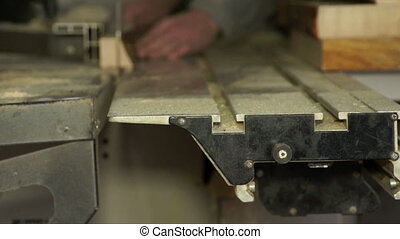 Piece of wood in a process of cutting. - Piece of wood in a...