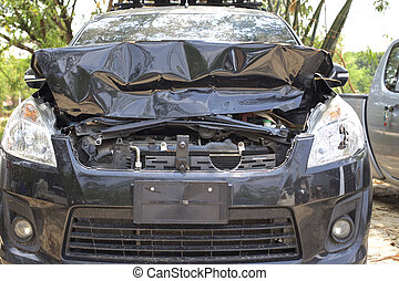 Car Crash - A wrecked car lays in wait after a vicious car...