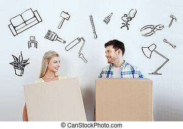 smiling couple with big boxes moving to new home - home,...