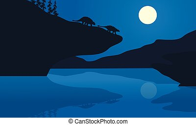 Silhouette of ankylosaurus at the night