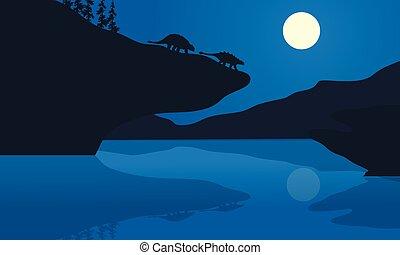 silueta, de, ankylosaurus, en, el, noche,