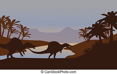 Silhouette of dinosaur in lake