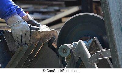 Cutting wood - Man cutting the log on circular saw Cutting...