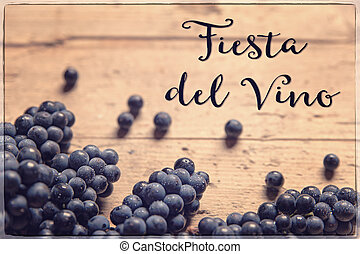 blue grapes on wooden table, spanish text, filtered - blue...