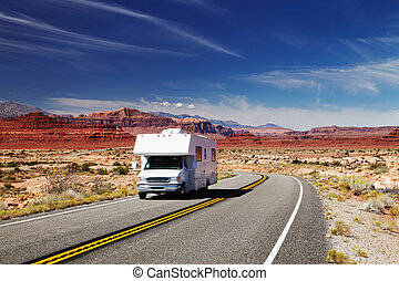 RV Camper on highway - Traveling by motorhome, American...