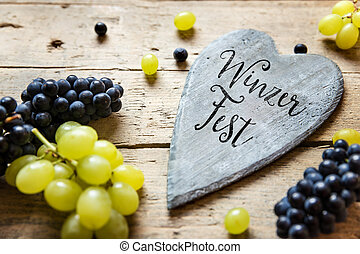 Blue and white grapes and a wooden heart with a word - Blue...