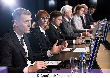 Politician debating at auditorium - Politician debating at a...