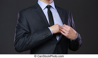 man businessman nearsighted holding glasses. man in a business suit pulls Glasses