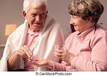 This medicines should help you - Senior woman giving...