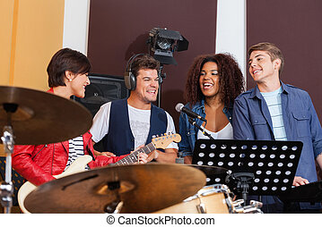 Cheerful Band Members Performing Together