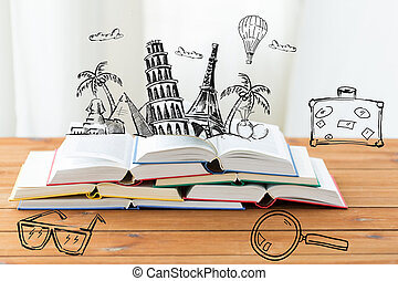 close up of books on table with landmarks doodles -...