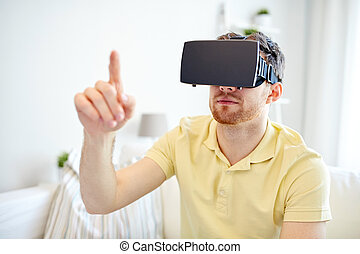 young man in virtual reality headset or 3d glasses -...