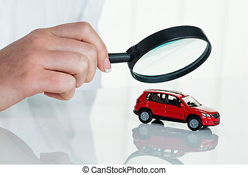car is being examined by doctor - a model of a car is...