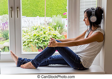 woman listening music with headphones relaxation and relax