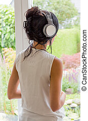 woman listening music with headphones. relaxation and relax