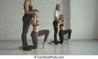 Two Yoga Fitness Girls Help Their Partners To Stretch Legs...