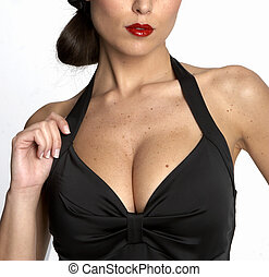 Sexy womans cleavage - Large breasted woman in a black dress...