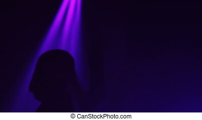 girl dancing in night club. silhouette