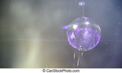 disco ball glows in the club - a disco ball lights up and...