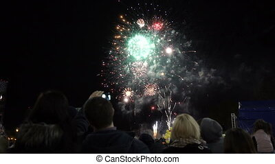 People look at fireworks - people look at the fireworks in...