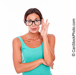 Mistaken caucasian woman touching her glasses while looking...