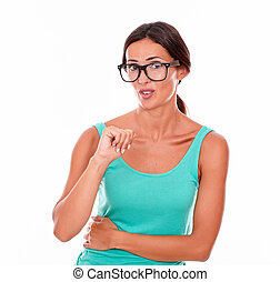 Mistaken caucasian woman pointing at herself while looking...