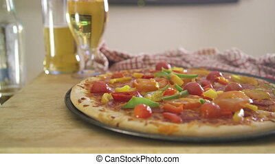 Pizza, Beer and TV - Pan of a vegetable pizza and some...
