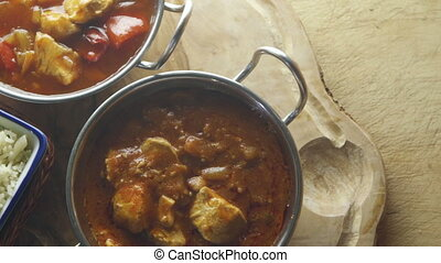 Indian Curry and Rice - Ariel pan view of chicken and...