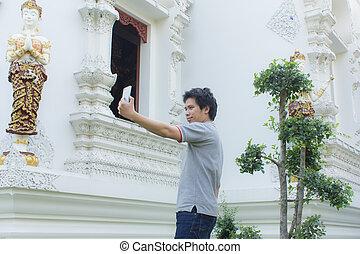 thai man Selfie at thai temple