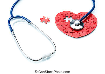Heart disease, puzzle heart with stethoscope on white...