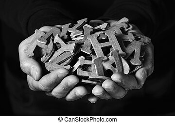 man with wooden letters in his hands - closeup of the hands...