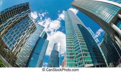 Top of Moscow-City buildings with sky with clouds above...