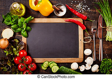 Chalkboard Surrounded by Herbs and Vegetables - High Angle...