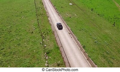 Aerial View Of The Road With Driving Car - Camera follows...