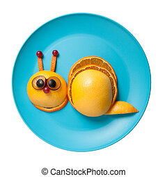 Funny snail made of fruits on plate