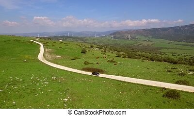 Aerial View Of The Hilly Terrain - The camera flies over the...
