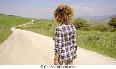 Woman Walking Down The Country Road - Side view of sexy...