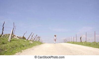 Woman Walks Along An Empty Road - Wide angle of young sexy...