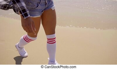 Young Sexy Woman Walking On The Beach - Close up of legs of...