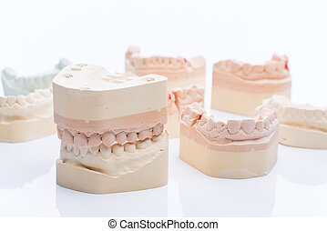 Teeth molds on a bright white table - Teeth molds on a...