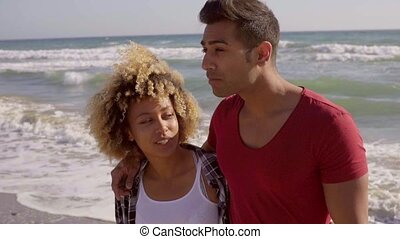 Young Mixed-Race Couple On The Beach - Portrait of young...