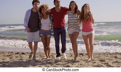 Young People On The Beach - Young attractive people walking...