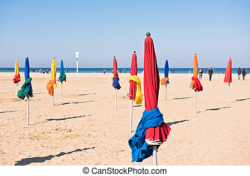 The famous colorful parasols on Deauville beach, Normandy,...