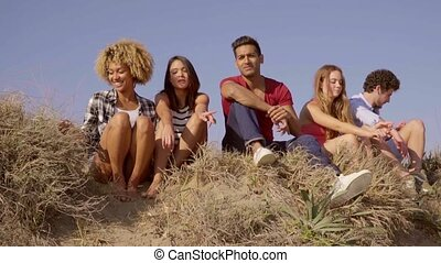 Friends Have A Great Conversation - Group of five young...