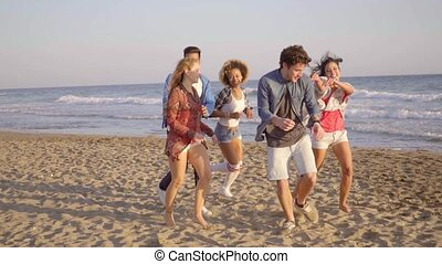 Young People Running On The Beach - Five young attractive...